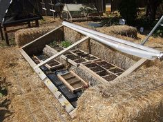 SBG pin of the day!  Coldframe of straw bales, simple 2x4 frame and roll up plastic.  Face it south, mind you!