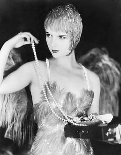 """1920 film called """"the canary murder case"""" starring Louise Brooks..adoring strainds of pearls.."""