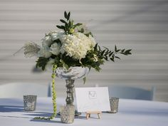 Floral centerpieces and instagram hashtags for this March wedding reception!