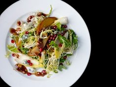 Roasted Pear Salad with Endive, Pomegranate, Blue Cheese, and Hazelnut Vinaigrette: A hearty sweet and savory salad for wintry weather.