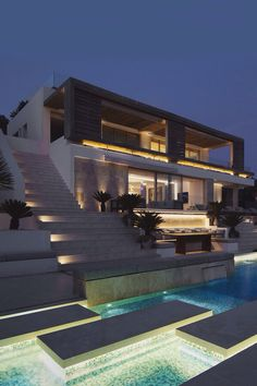 Beautiful pool with lighted stepping slabs.