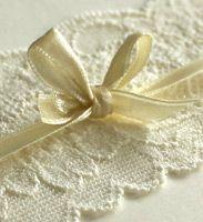 close up of lace invitation