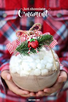 Ornament filled with Hot Chocolate - mix hot cocoa in a large plastic ornament then add mini marshmallows on top for a quick and easy DIY Christmas gift. #DIYChristmasGift #HomemadeChristmasGift #DIYChristmasOrnament #HotCoCoaMixOrnaments