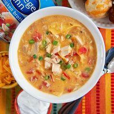 King Ranch Chicken Soup Recipe Soups with cream of chicken soup, cream of mushroom soup, diced tomatoes and green chilies, College Inn Chicken Broth, onion powder, garlic powder, chili powder, cumin, rotisserie chicken, Velveeta, corn tortillas
