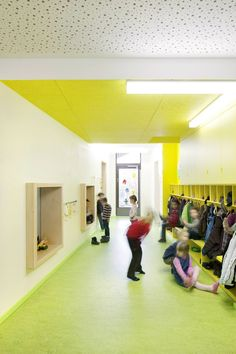 Kindergarten Lichtenbergweg Coat hooks, cubbies, window seats, plywood relites, acoustical gypsum, painted tectum acoustical ceiling panels
