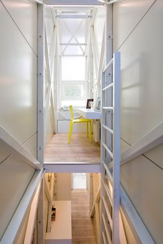 """The Keret house is the world's thinnest house, Warsaw, Poland, by architect Jakub Szczesny.   The house is inspired by Israeli writer Etgar Keret who produced a collection of very short stories (such as """"Suddenly, a Knock on the Door"""").  After hurdles of planning and construction permits, """"We had heart attacks, one after another"""", the house is completed."""