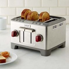 Bring the professional performance and distinctive style of Wolf appliances to your countertop with the Wolf Gourmet toaster. A striking complement to the iconic Wolf range, this toaster has extra-large slots and ensures custom browning of … Kitchen Appliance Storage, Kitchen Tray, Kitchen Items, Wolf Kitchen, Kitchen Reno, Kitchen Stuff, Kitchen Utensils, Kitchen Tools, Kitchen Gadgets