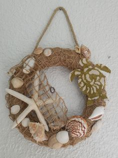 "A friend was over today, I suddenly had a idea what to do with a green wreath I had. I held the wreath and the burlap in my hand and said ""I have a idea for the…"