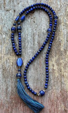 Mala made of 108, 8 mm - 0.315 inch, lapis lazuli gemstones and beautifully decorated - Made by look4treasures