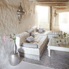 Moroccan-inspired boho chic living space in a natural hand made home. Such peace.