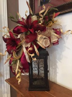 This Burgundy Lily swag is made to fit on a 14 inch lantern or larger.  It shows with Burgundy ,creme ,Moss and burlap deco mesh  There are