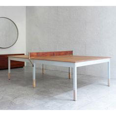 Ping Pong Table - large table that could fold over onto itself to free space.
