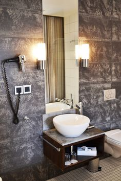 Great bathroom tiles.  Makes me feel like going on holiday to a nice luxe hotel.
