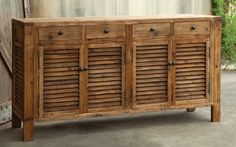 Rustic Shutter Cabinet.  The overall look is one of an old fashioned sideboard or buffet. $3189.