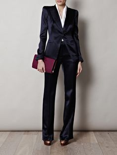 From a label famed for their exquisite tailoring, this navy satin tuxedo suit from Alexander McQueen is a sophisticated addition to your sartorial portfolio. Slip it on with a silk shirt and sky-high heels as a show-stopping cocktail hour ensemble. Shown here with YSL clutch and top and Vionnet sandals.
