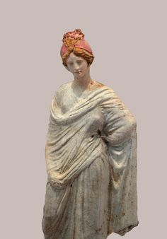 chignon - Figurine of a woman, from the exhibition Aspects of youths' life in Ancient Macedonia, from the Museum of the Roman Forum (Thessaloniki)