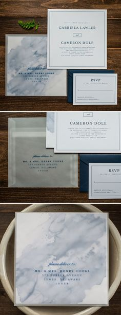 Watercolor Wedding Invitations with Vellum Envelope by Penn & Paperie. A blue watercolor design is printed on the back of the invitation so that it shows through the frosted vellum envelope.