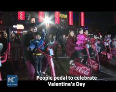 Many people have flocked to the Oriental Pearl Tower, a landmark in east China's Shanghai, to celebrate Valentine's Day by pedalling. Specially designed stationary bikes have been installed around the tower. As riders pedal, the bikes generate electricity which then helps light up the tower in red. Watch it!