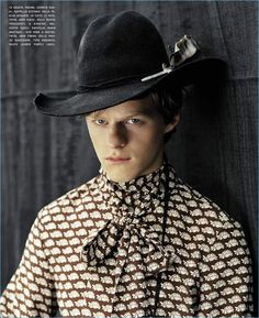 Actor Lucas Hedges dons a Gucci printed shirt with a Stetson hat.