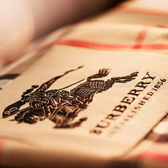 The label of the Burberry heritage trench Coat features the Burberry Knight motif – a winning entry from a design competition circa1901