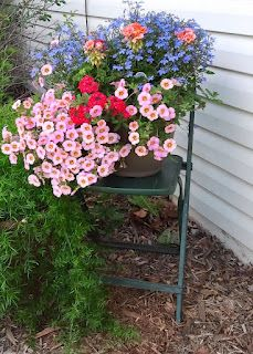 Great use of color....  BarnNumber2: Please take a seat! Vintage chairs as plant stands