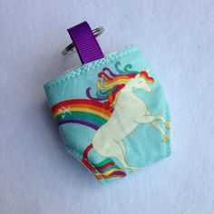 Cute little cloth nappy keychain made with Riley Blake Unicorns and Rainbows fabric Great accessory for your changing bag Fleece lined and working snaps  If you have any questions, please feel free to send me a message!  You can also find me on Facebook https://www.facebook.com/pages/Girls-Got-Fabric