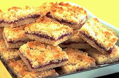 Raspberry jam coconut slice - i use GF flour instead and mix in a little lemon juice to the dough mixture to cut the sweetness of the berry jam Raspberry Coconut Slice, Coconut Jam, My Favorite Food, Favorite Recipes, Walnut Cake, Sans Gluten, Healthy Desserts, Baking Recipes, Great Recipes