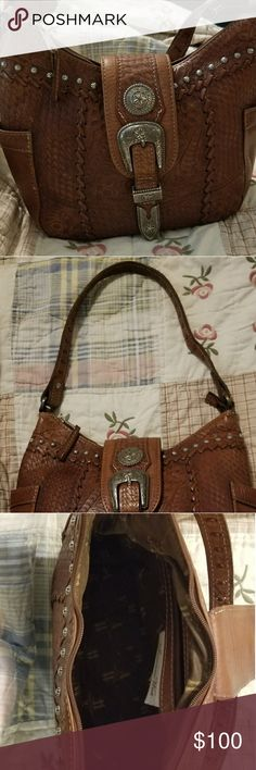 American west purse Brown leather western purse used a few times has light  Scuffs on bottom. American West Bags Shoulder Bags