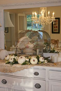 Vintage china in a vintage birdcage! Paint the old birdcage to use tfor displays