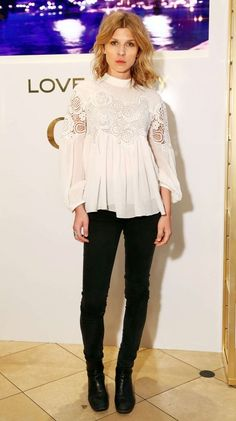 Clemence Poésy in a white peasant top and black skinny jeans