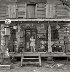 """July 1939 ~  """"Daughter of white tobacco sharecropper at country store in Gordonton in Person County, North Carolina.""""  Medium-format nitrate negative by Dorothea Lange.  #South #Southern"""