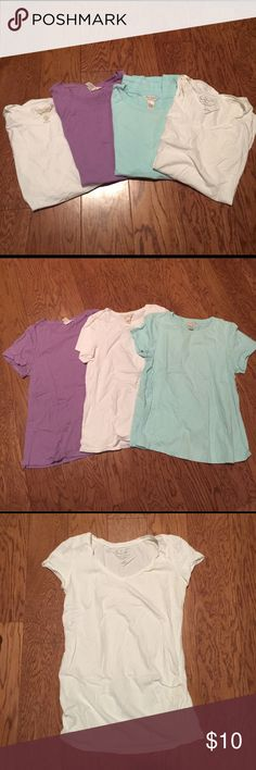 Lot of 4 short sleeve Maternity T-shirts Size Small. Lot of 4. Maternity T shirts. 3 Three Season Maternity (2nd pic) crew neck t shirts. 1 Bump Start (3rd pic) v-neck t-shirt with rouching at the sides. Three Seasons Maternity Tops