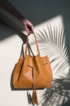 4e3afd860420 Maria Tassel Shopper in Cognac Effortlessly feminine and equally  functional. The Maria Tassel Tote elevates