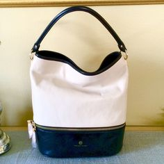 """TRINA TURK LEATHER HOBO BAG HOST PICK 5/2/16 & 4/6/16Brand new with tags.  This bag is gorgeous!  Black & cream leather color block combo. Single 12"""" drop strap. 2 exterior zip pockets at the bottom and back of the bag.  This bag is fully lined with one interior zip pocket and 2 open slip pockets. Trina Turk Bags Hobos"""