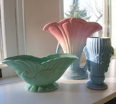 love-the pink, white and blue in the center, is Hull pottery.