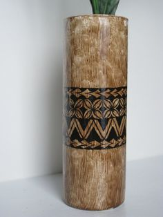 Tapa Cloth/Bark Cloth Style Tall Cylinder Vase with Handpainted Polynesian Inspired Design. $18.00, via Etsy.