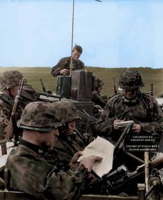 A group of soldiers from the Das Reich Division stopped to consult a map and conduct a radio check during Operation Barbarossa in 1941.