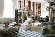 another view of living room into dining room with bookcases so also a library----would work in Malibu