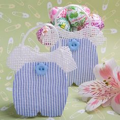 Adorably cute � your guests will �jump� at the chance to grab one of these Baby Boy Blue and White Striped Jumper Treat Bags!  This miniature version of one of baby�s first items of clothing is the perfect choice for a baby shower favor.  Our treat bag features white woven rattan construction, blue and white striped fabric detailing and a star-shaped blue button appliqu� on the front.  A small Velcro tab at the top helps keep the bag shut, if needed, and a there is a white rope handle for…