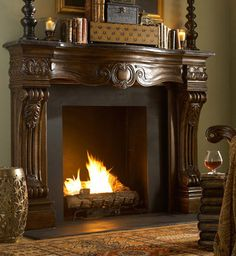 Ornately carved scroll and leaf columns, a dark finish, and dark brown marble top make this fireplace spectacular. Truly a builder friendly fireplace surround, the decorative cast stone used in Ambella Home Collection Fireplace Surrounds is a carefully selected combination of select and premium c...