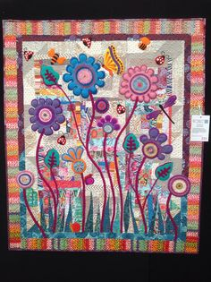 Baby blooms by Wendy Williams where she used her scraps to make the background. It looks very effective. It too is hanging in the 2014 Craft and Quilt Fair at Glebe Island. You have to see it up close to appreciate the hand embroidery work and the colours she has used.