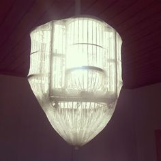 I needed help from my electrician husband for this one. An old and worn decoration bird cage turn into an living room light. Covered the cage with lace curtain.