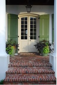 Love the operating shutters...and the color