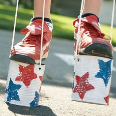 Tin Can Stilts- FUN craft for kids that doubles as a toy. What a great idea for #summer! #DIY #crafts #kids #stilts