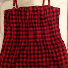 New York & Company Red & Black Plaid Tank Red and black plaid New York & Company tank top. Pleated in front with zipper down side for closure. Small hole at bottom of zipper however barely noticeable. Great piece on its own or layered. Material: 100% polyester New York & Company Tops Camisoles