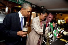 Obama watching Michelle pull a pint in Ireland (May 2011).