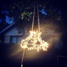 Tutorial: Outdoor chandelier made of Christmas lights and an old lamp shade. The Baby Giraffe: Outdoor Chandelier Tutorial