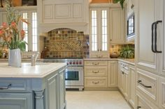 Antique white cabinetry in a traditional kitchen (Ranario)