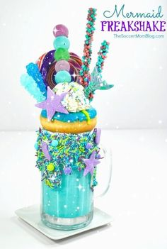 """""""Ariel"""" Mermaid Freakshake Let your culinary imagination run wild with this over-the-top spectacular Mermaid Freakshake! Candy Drinks, Fun Drinks, Yummy Drinks, Cute Desserts, Delicious Desserts, Yummy Food, Milk Shakes, Crazy Shakes, Mermaid Cupcakes"""