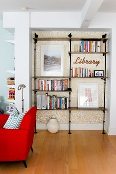 Living Room Pipe Shelves kind of really awesome for my living room. I want it now :)